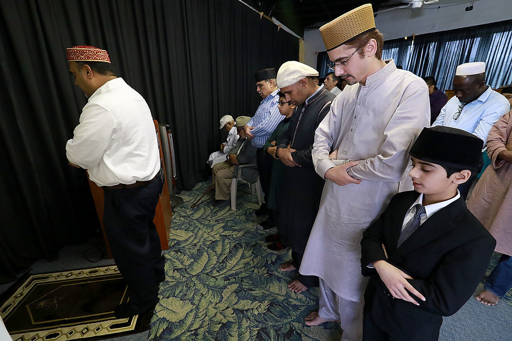 """. The Muslim holiday of Eid Al-Adha, also called the \""""Festival of Sacrifice\"""", was celebrated at Masjid Bait-ul-Zikr mosque in Fitchburg on Wednesday morning. Worshipers prays during the ceremony at the mosque. SENTINEL & ENTERPRISE/JOHN LOVE"""