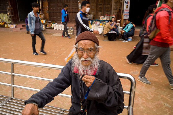 Old Man With Prayer Beads