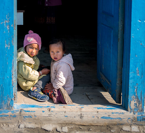 Children in the Doorway With Early  Morning Sun