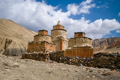 Padmasambhava's Chortens with the Red Cliffs of Dhakmar in the Background