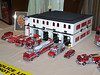 Factory and kitbashed Code 3 LA City rigs and a Lego fire station.