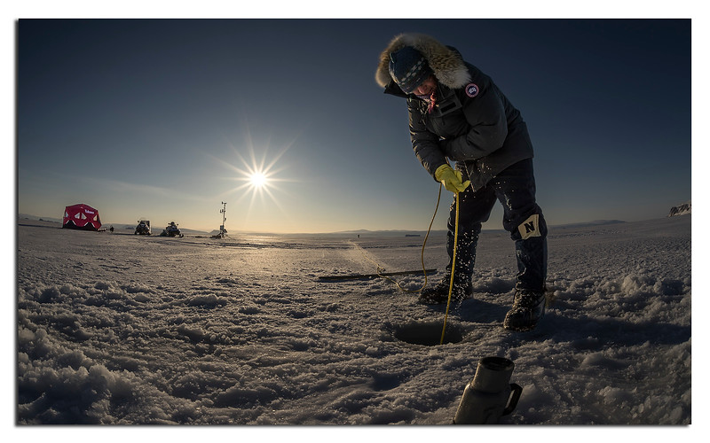 625. Andreas Muenchow from the University of Delaware hoists a probe up from sea water below  the ice.
