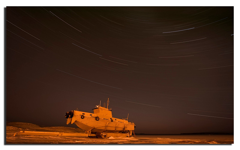 17. Startrails captured during the long and dark Winter. The boat belongs to the US Air Force, and helps the incoming ships in Juli and August. Thule Air Base.