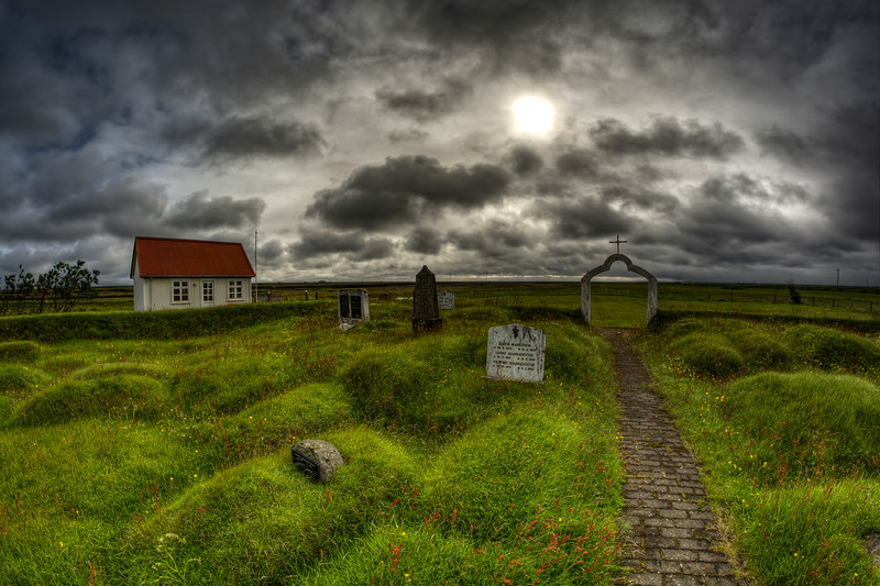 Sun Peeking Through Over Cemetery In South Iceland
