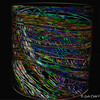 """""""OLIVE BLANKET CYLINDER (2010)"""" by Dale Chihuly (The Metamorphosis)<br /> <br /> """"In 1974 we came up with a way to pull colored glass rods into long, thin threads. This allowed us to make drawings out of glass that we could then pick up onto the outside of a gather of glass. We knew right away that drawing on glass was a breakthrough idea. . . ."""" ~ Dale Chihuly<br /> <br /> Hand blown glass ~ 8 x 7 x 7 inches<br /> <br /> Another one of my artistic creations, post processed with Topaz Labs (a 30-day trial version that ended 2/6/2015).<br /> <br /> View the original photo here:<br /> <br /> <a href=""""http://godschild.smugmug.com/ArtScape-1/Dale-Chihuly-Recent-Works-and/i-83C6nbd/A"""">http://godschild.smugmug.com/ArtScape-1/Dale-Chihuly-Recent-Works-and/i-83C6nbd/A</a><br /> <br /> Dale Chihuly:  """"Recent Works and New Forms"""" 2012<br /> @Talley Dunn Gallery<br /> 5020 Tracy Street<br /> Dallas, Texas 75205<br /> (214) 521-9898<br /> Official website is here: <a href=""""http://www.talleydunn.com"""">http://www.talleydunn.com</a><br /> <br /> (original photo taken 6/29/2012; post processed on 1/10/2015)<br /> <br /> My Homepage:  <a href=""""http://www.Godschild.smugmug.com"""">http://www.Godschild.smugmug.com</a>"""