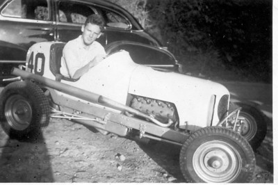 My dad in 1944 in the Panama Canal Zone in his first car - a Ford V-8 powered quarter midget. He used to zoom around the Canal Zone in this thing until he put it through the side of a barn and the base commander made my grandad take it away from him.