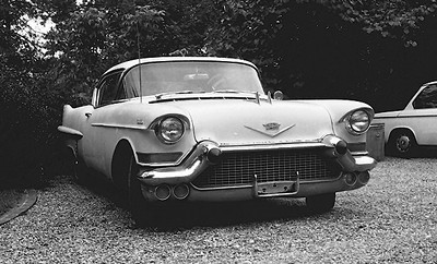 My last American car - turquoise/white 1957 Cadillac Coupe De Ville - great fun! That's my BMW 1600 in the background.