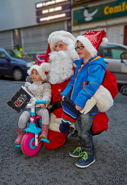 Santa with Happy Kids at the Christmas Carnival in Glasgow - 23 November 2014