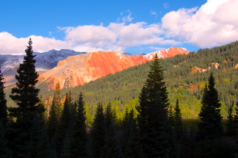 Colorado's San Juan Skyway wind through narrow canyons and open valleys, overlooking spectacular views of 14,000 ft. mountain peaks, and is speckled with historic mines and victorian towns.