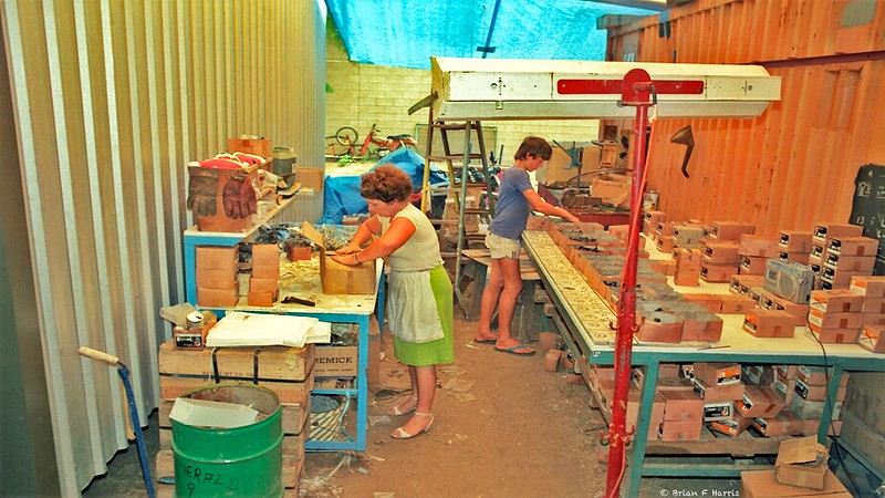 1984 after we had gone to Mackay and brought back the kit roller door shed on right. Craig and Barbara are working on the ' Famous Bag of Bolts ' which started our business at Greenbank.