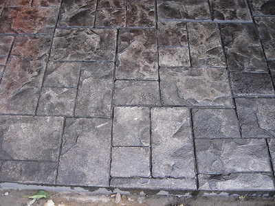 Close up of stamped concrete showing color variation and surface