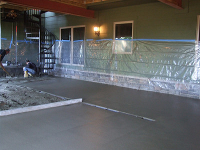 Pouring cement under deck; done in two pours