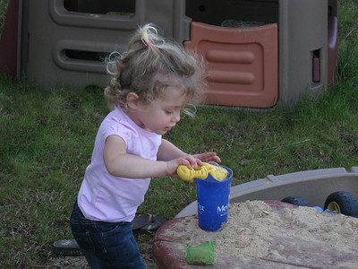 Playing in the back yard sand box