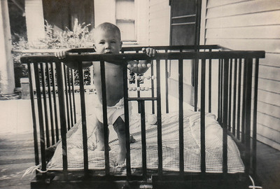 In playpen on front porch of G&G's house