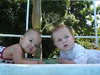 Cayden and little Lilly by the pool. Cayden 4 months, Lilly 8 months.
