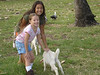 Claire and Erin, the 2 girls I was taking care of, petting a goat.