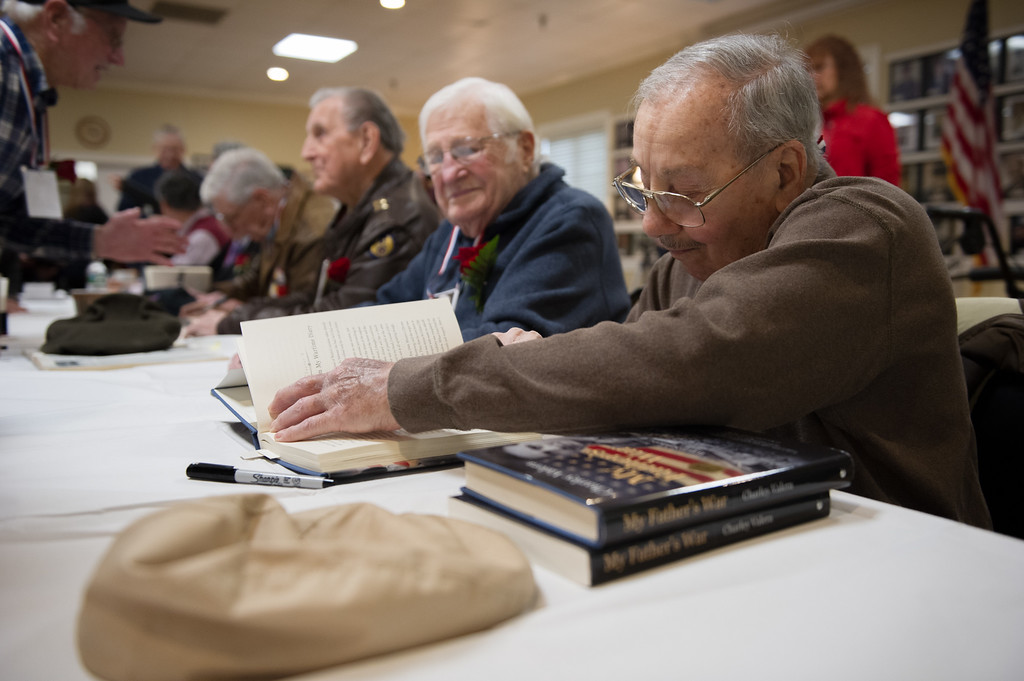 . 03/26/17 LEOMINSTER with story-- Santo J. DiSalvo signs a book during Sundays book signing at the Veterans Center in Leominster on March 26, 2017. (Sentinel & Enterprise photo/Jeff Porter)