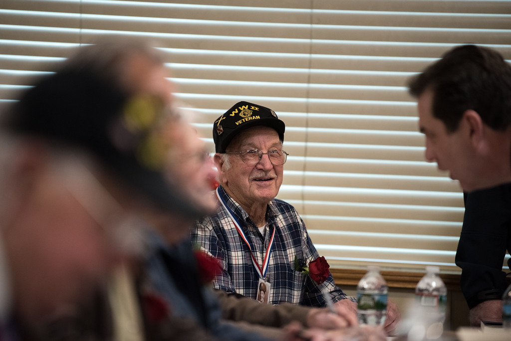 . 03/26/17 LEOMINSTER with story-- World War II Corporal Charles M. Sanderson sit\'s at the end of the table signing books during Sundays book signing at the Veterans Center in Leominster on March 26, 2017. (Sentinel & Enterprise photo/Jeff Porter)