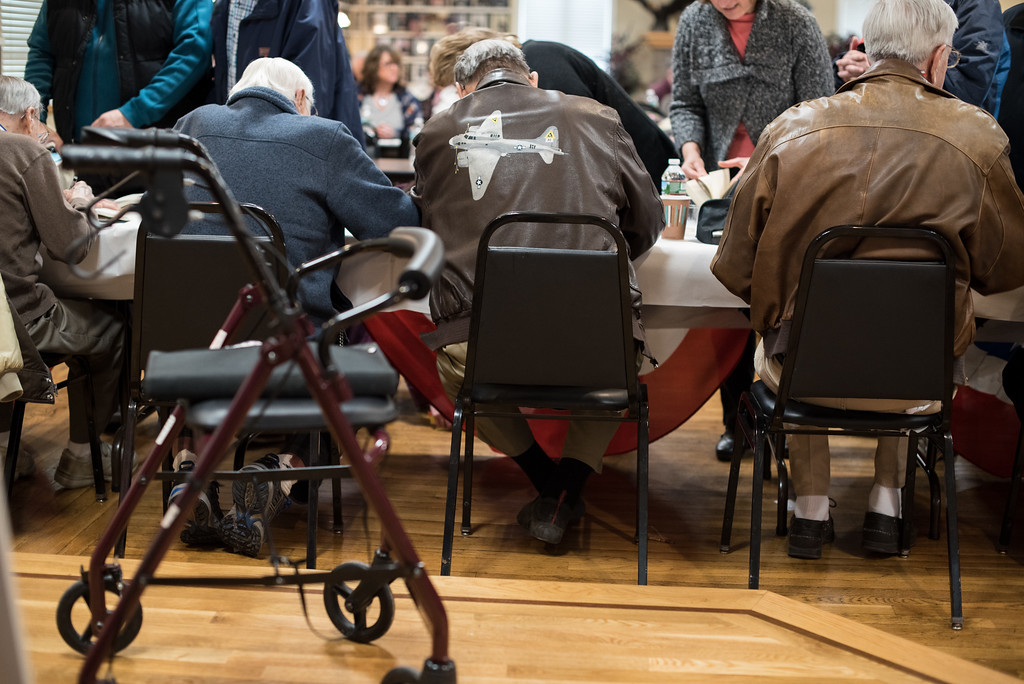 . 03/26/17 LEOMINSTER with story-- World War II veterans sit at a long table signing books during Sundays book signing at the Veterans Center in Leominster on March 26, 2017. (Sentinel & Enterprise photo/Jeff Porter)