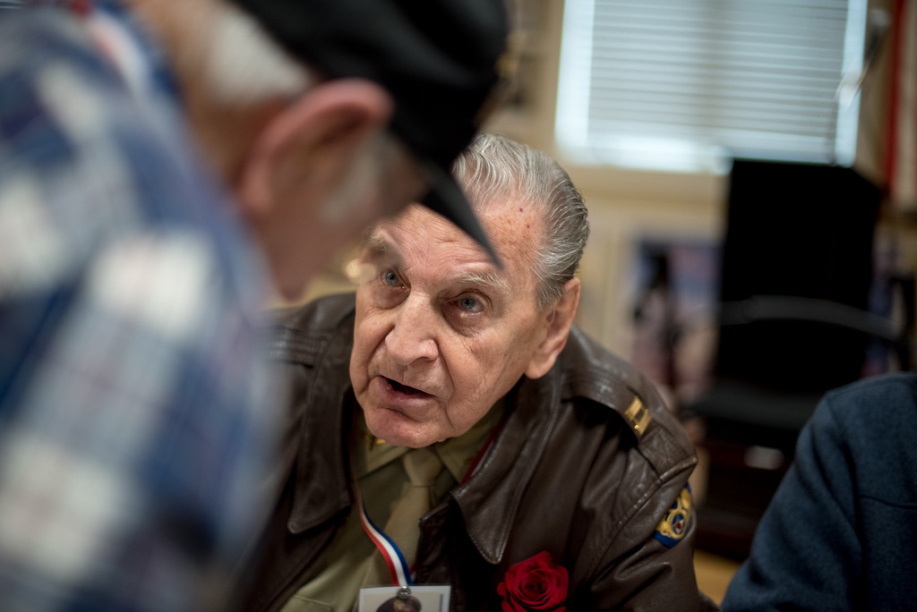 """. 03/26/17 LEOMINSTER with story-- World War II veteran Vincent \""""Bill\"""" Purple speaks to a fellow World War II vet at the book signing on of \""""My Father\'s War\"""" at the Veterans Center in Leominster on March 26, 2017.   The book was writtin by local author Charley Valera.  (Sentinel & Enterprise photo/Jeff Porter)"""