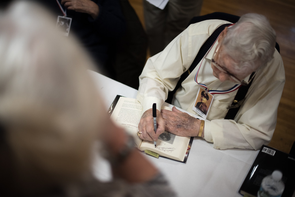 """. 03/26/17 LEOMINSTER with story--World War II veteran Charles R. Rogers signs a book during Sundays book signing of \""""My Father\'s War\"""" written by local author Charley Valera.  The World War II veterans featured in the book came together on Sunday to sign books on March 26, 2017 at the Veterans Center in Leominster.  (Sentinel & Enterprise photo/Jeff Porter)"""