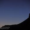 Crescent moon and North Six Shooter tower. Canyonlands, Utah