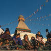 Children under the prayer flags at Boudhanth Stupa, Kathmandu, Nepal