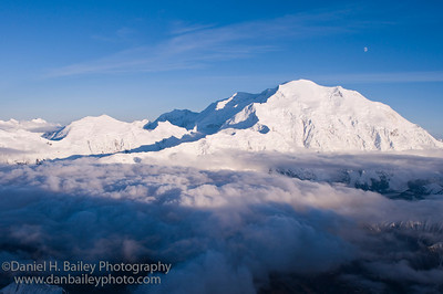 Aerial photo of Denali and the moon. Denali National Park, Alaska