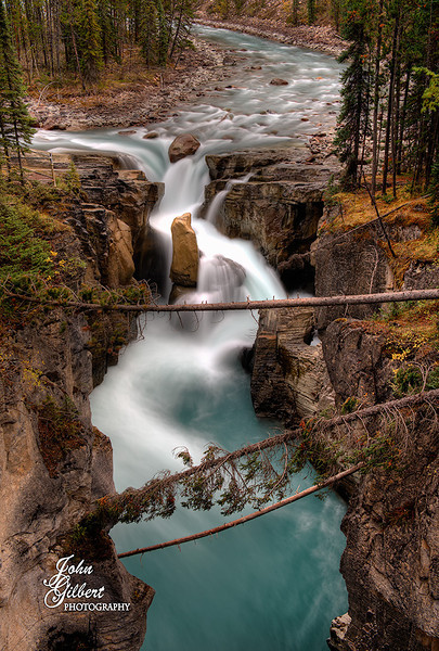 Sunwapta Falls 10/01/2013: We arrived very early and were the only ones there.  It was cold and spitting snow.  The falls is fed by the Sunwapta River coming from the Columbia Icefield.  Nikon D600, 24-70mm lens @38mm. Aperture f/8, Shutter Speed 1.6; 1.0; 2.5; seconds, ISO 200, and 0EV; -0.67EV; and +0.67EV.  This consisted of three separate shots blinded together in PS6.  Tripod.