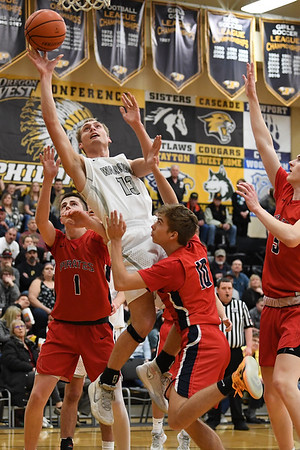 Toby Steuve of Philomath takes a tough shot undernath. The Warriors advanced to Forest Grove with a 48 to 45 win over Phoenix Friday Night.