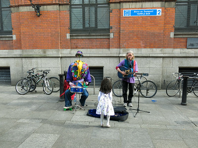 This little girl is interested in the local street entertainment. Ireland 2013.