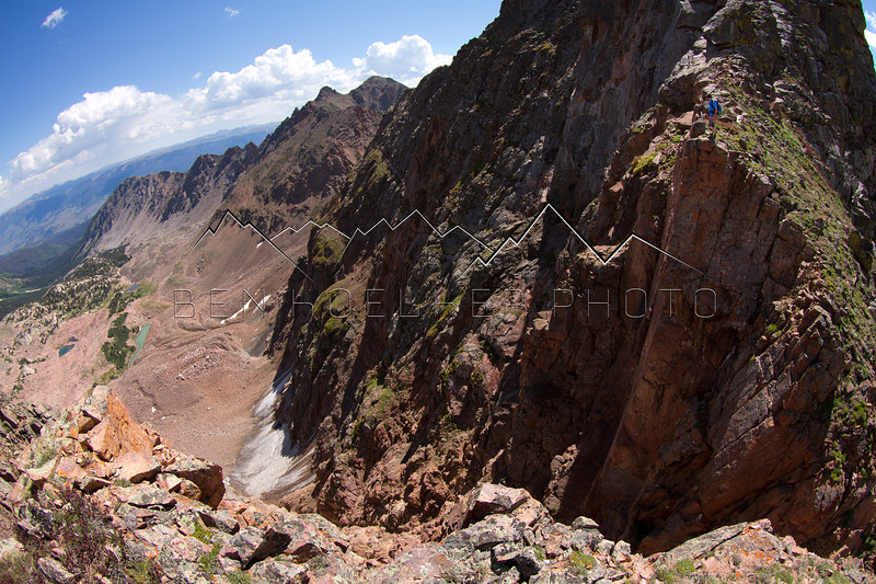 Mark Koelker atop a cliff on The Grand Traverse in the Gore Range, CO.