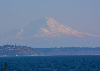 03-23-14 In the late afternoon Mount Ranier seemed to float in the distant sky.  The picture is on the return ferry from Bainbridge Island back to Seattle.