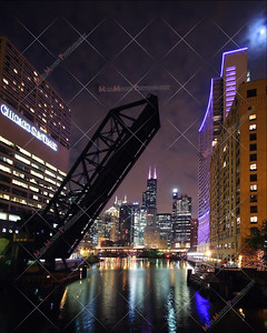 Second place ribbon winner in dpchallenge.com's Night Shot Challenge.  This version of the image has been altered to straighten out the buildings that were distorted due to the use of a wide angle lens.