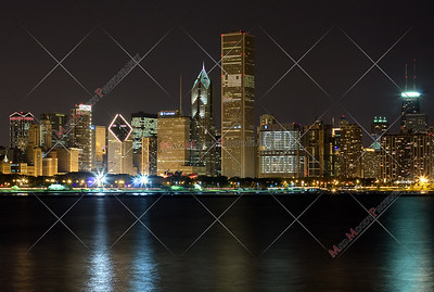 Chicago skyline at night as seen from the museum campus including a Chicago Police Department (CPD) tribute.