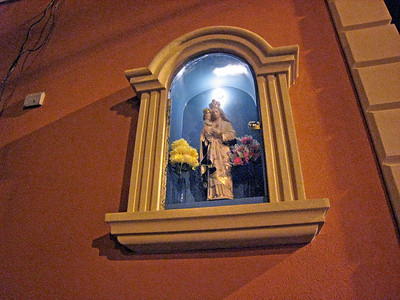 This outdoor shrine is on the side of a house on the NW corner of Wyckoff Avenue and Greene Avenue in Ridgewood, Brooklyn.