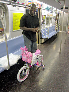 Met this fellow on the Myrtle Avenue El, at the the Metropolitan Avenue terminal.  It was a beautiful summer's evening, just after sunset.  He had just bought the cutest little pink bicycle you ever saw from Toys R Us, no doubt for his little girl.  (July 11, 2008)