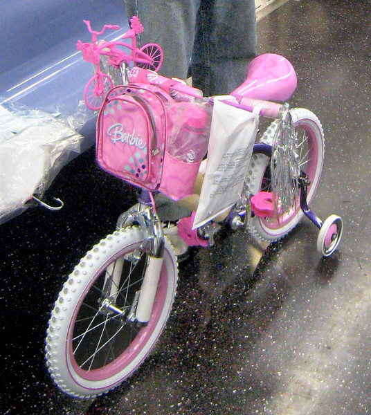 Look, there's even a littler pink bicycle on the handlebar!