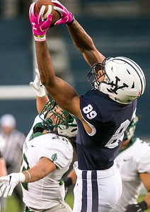(John Vanacore/For Hearst Connecticut Media) Yale's D. Major Roman completes a pass over the top of Dartmouth's Bun Stratton(22) during the Big Green's win Friday night at Yale Bowl.