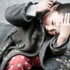 A girl brushing her hair at the Dickey Orphanage in Lhasa, Tibet