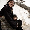 A mother and child outside Potala Palace, Lhasa, Tibet