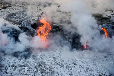 Lava flowing into the ocean on the Kona(western) coast of the island of Hawaii