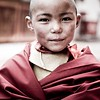 A young Buddhist monk at Potala Palace in Lhasa, Tibet