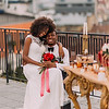 Charming black wedding couple tenderly hugging on the rooftop