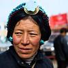 A Tibetan pilgrim at Potala Palace in Lhasa, Tibet