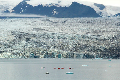 kayakers getting a closer look at a glacier