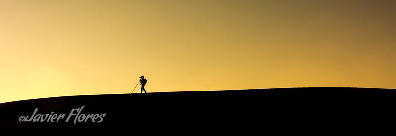 Photographer on the dunes