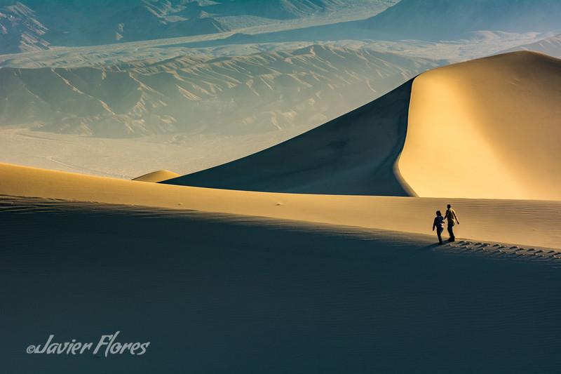 Couple Walking On Dunes