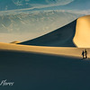 Couple Walking On Dunes
