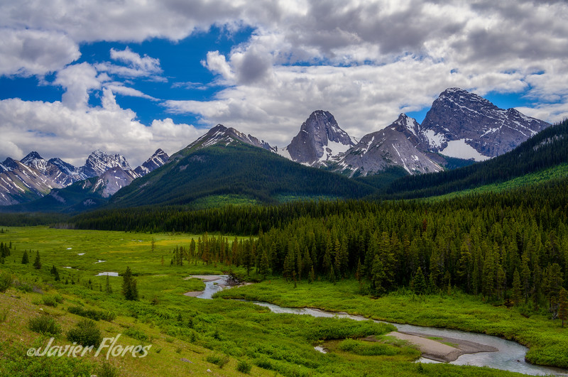 Canadian Rocky mountains with dramatic clouds.